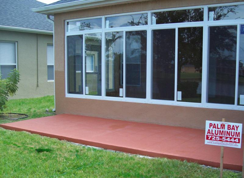 Replaced A Screen Enclosure With A New Glass Sun Room And An Open Slab Area  With Decorative Acrylic Paint For A Place To BBQ. Completed 9/2011